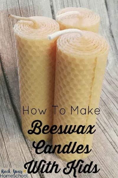 Beeswax candles on wood background