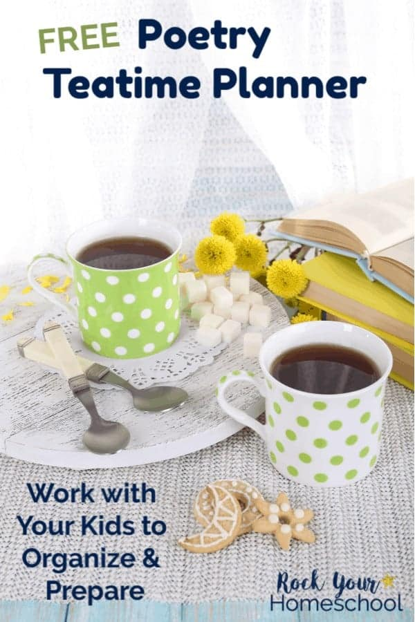 Green & white polka dot mugs with tea & yellow flowers & books & sugar cubes with spoons & decorative sugar cookies on linen