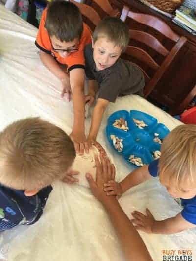 Seashell activities with playdough are super fun! Check out these 10 Creative & Frugal ways kids will love learning with seashells.