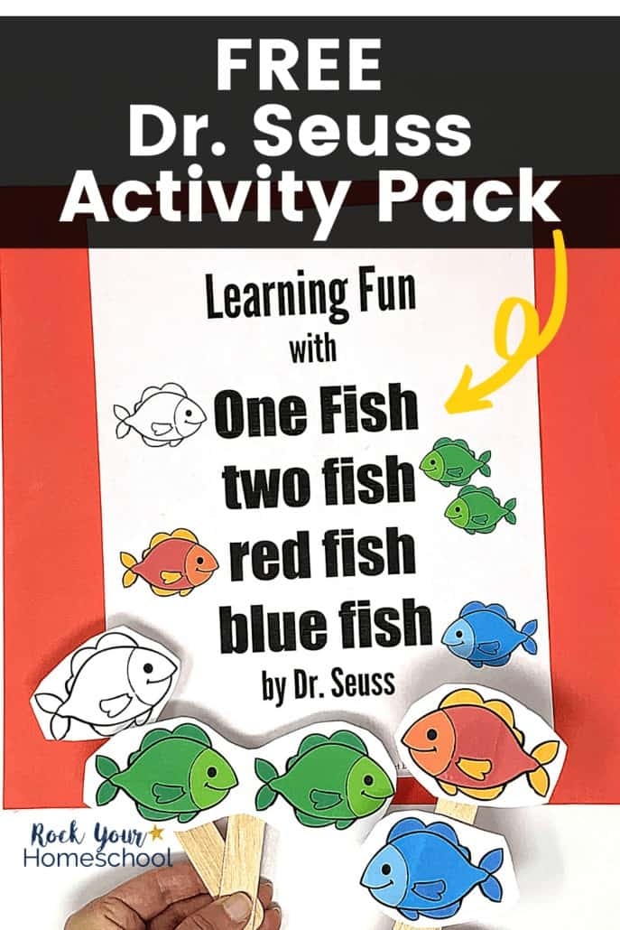 Woman holding One fish two fish red fish blue fish story props to feature how much your kids will have learning fun with this free printable pack of Dr. Seuss book activities