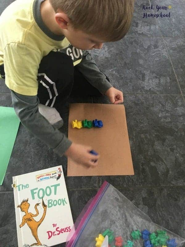 Use math manipulatives to measure feet! A fun learning activity found here for The Foot Book by Dr. Seuss.
