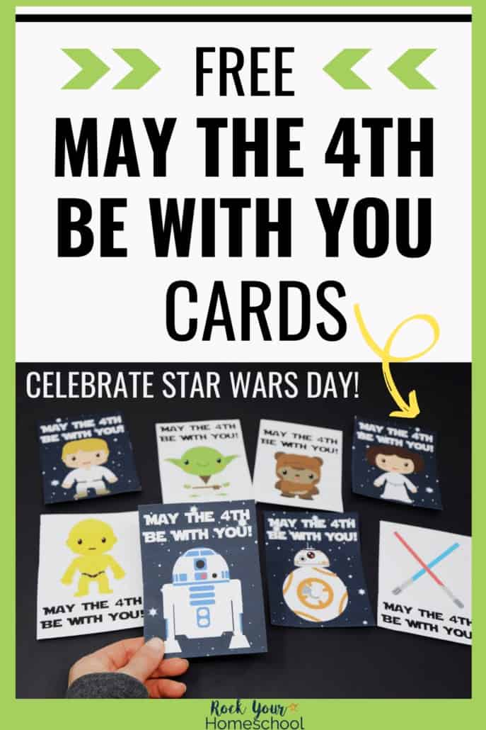 Woman holding R2-D2 card with May the 4th Be With You message with other free printable cards in background to feature how easy it is to celebrate Star Wars Day (May 4) with your kids using these cute cards