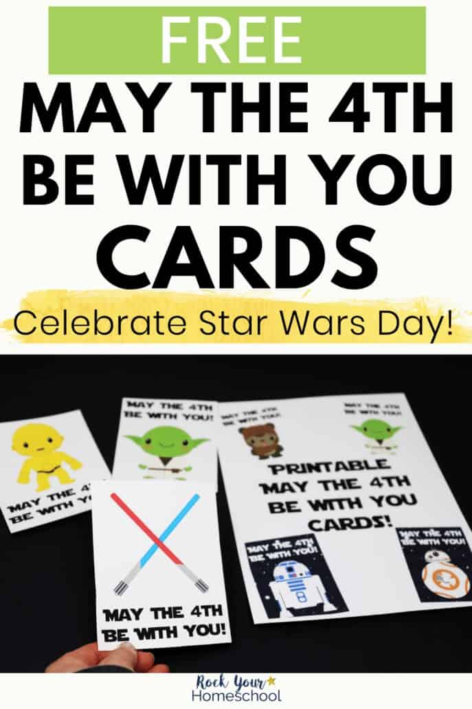 Woman holding May the 4th Be With You card with red & blue light sabers & other printable cards featuring C-3PO, Yoda, Ewok, R2-D2-, BB-8 to highlight the easy fun you can have with these free printable cards to celebrate Star Wars Day
