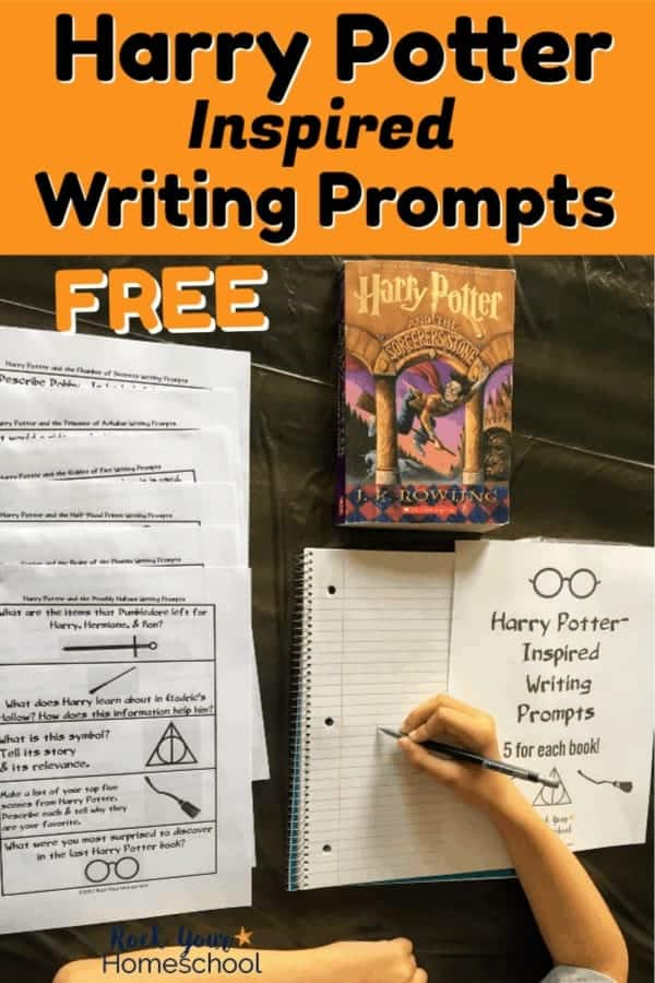 Boy writing in notebook using free Harry Potter-Inspired Writing Prompts & Harry Potter book on black tablecloth
