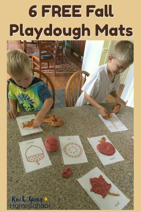 2 boys having fun with Fall-themed playdough mats