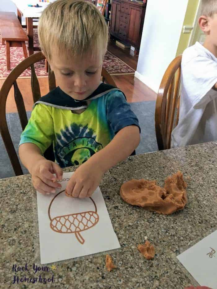 Have some fantastic learning fun with your kids with these free Fall playdough mats.