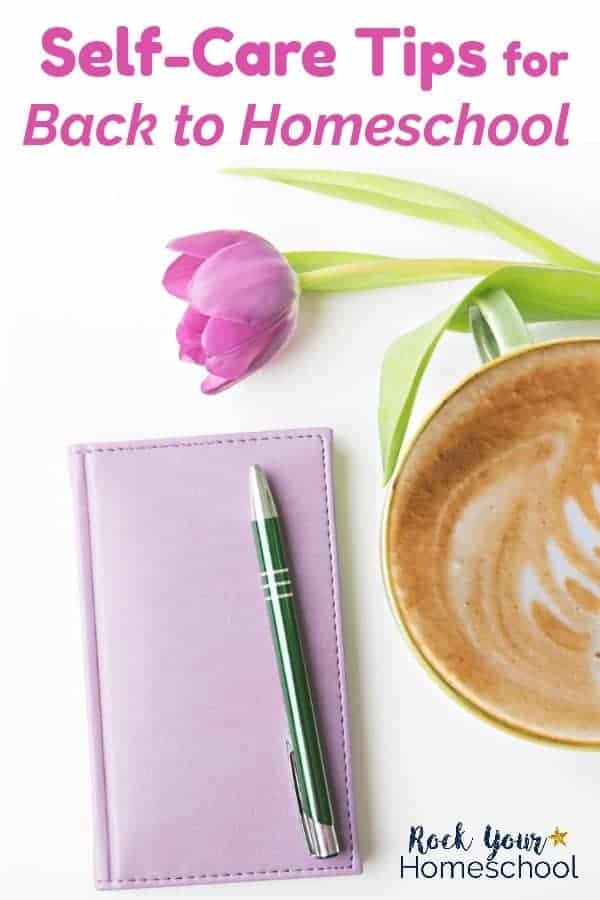 Pink tulip, lilac leather journal, green pen, & coffee on white background