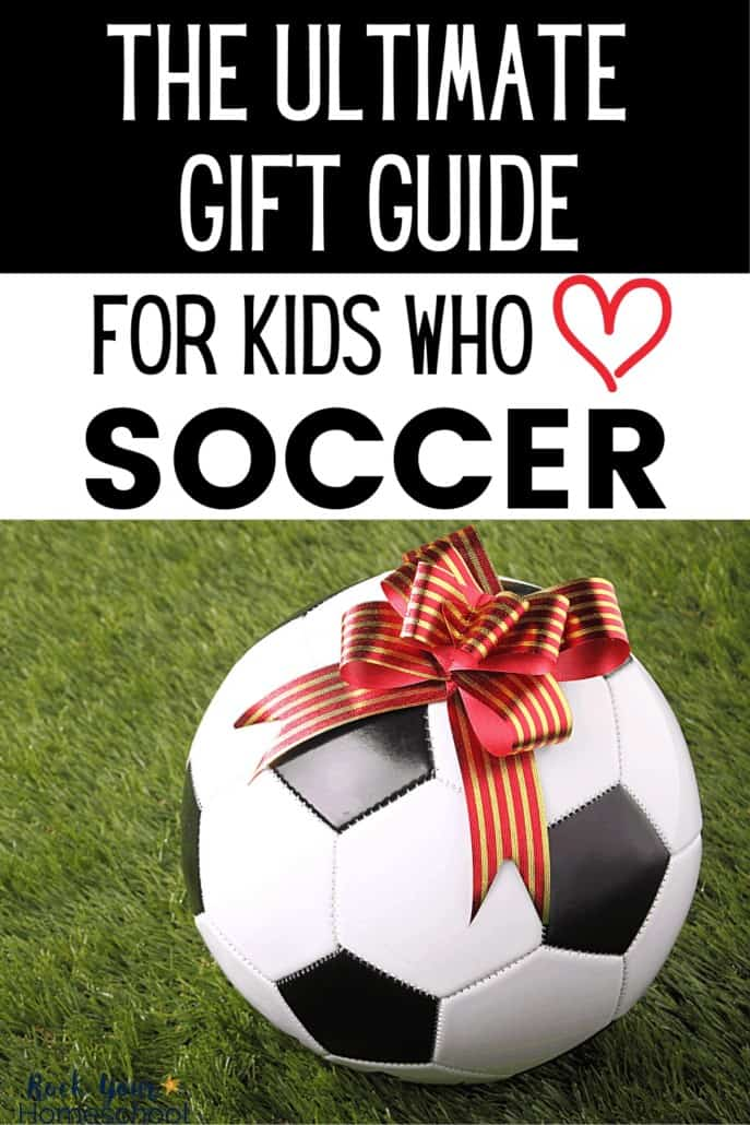 Soccer ball with red & gold ribbon on a grass field to feature how this ultimate gift guide for kids who love soccer will help you find the perfect present for your soccer fan