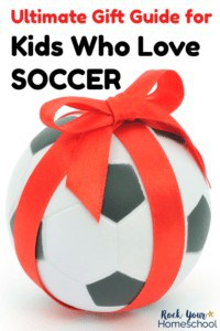 Soccer ball with red bow tied around it on white background