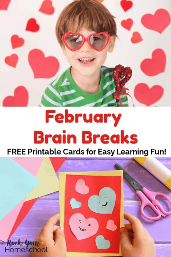 Boy wearing green & white stripe shirt & red heart-shaped sunglasses smiling & holding red heart wand with red paper hearts in background and blue, pink, yellow, & red construction paper & heart shapes for a card on purple wood background with pink scissors & yellow glue stick and a child's hands