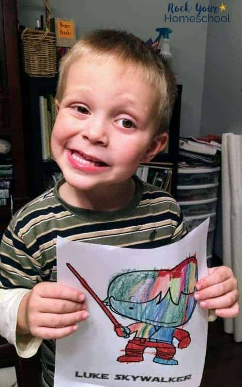 Boy holding Star Wars coloring page