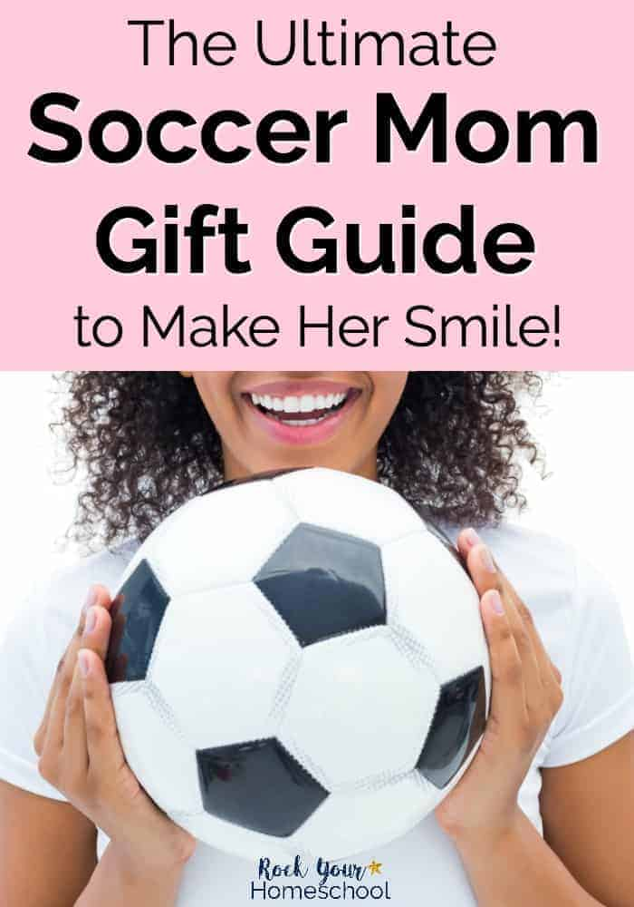 Smiling mom holding a soccer ball