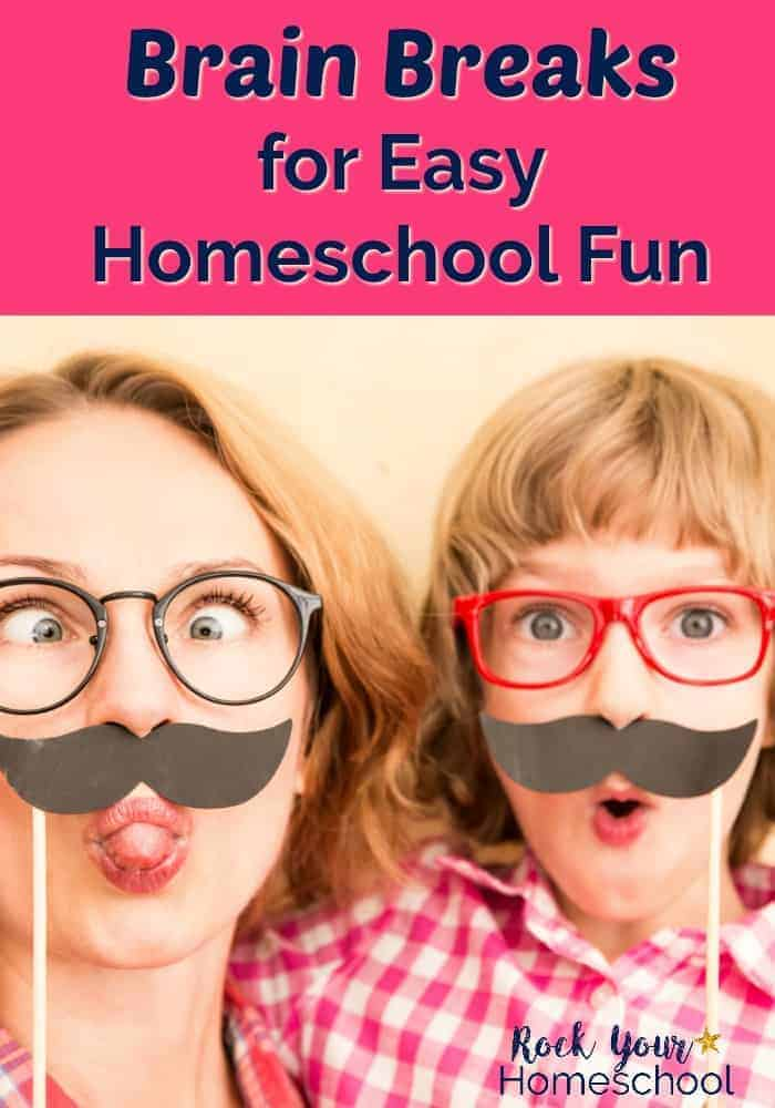 Mom wearing glasses is sticking out tongue while holding up mustache photo prop with child wearing red glasses & holding up photo prop