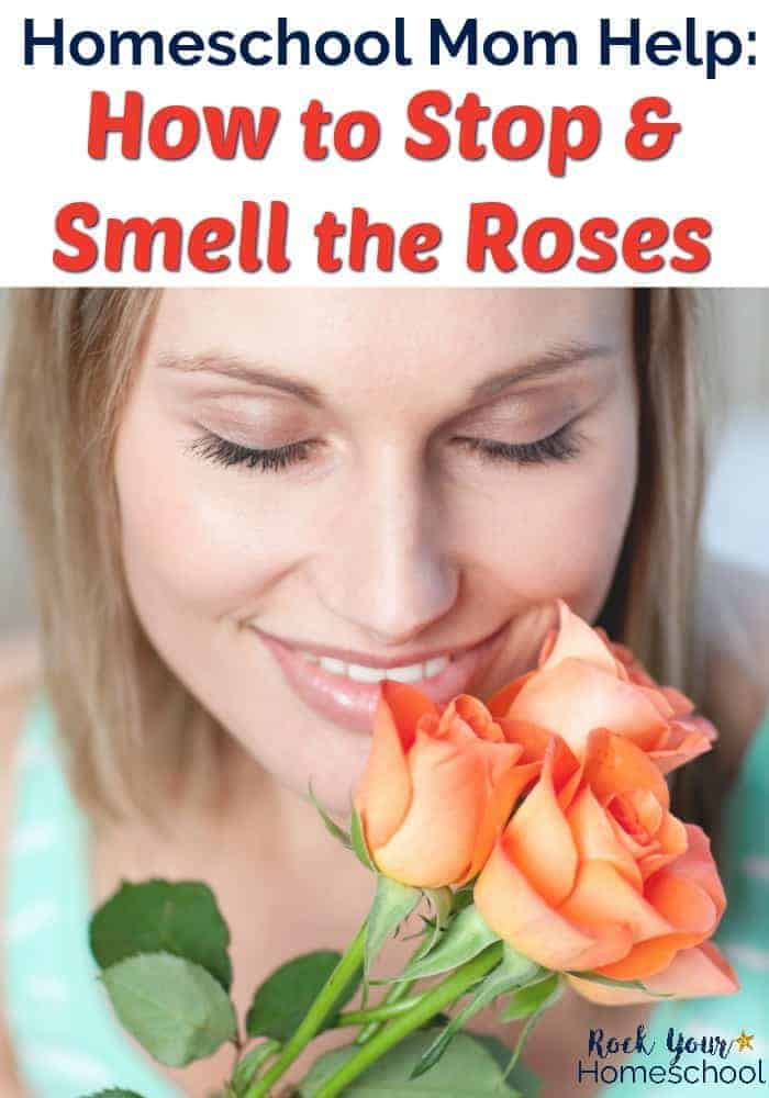 Woman with eyes closed & smiling smelling three peach roses