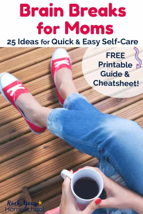 Woman wearing red & white sneakers & blue jeans is sitting with legs crossed & holding a white mug of coffee with red-painted finger nails on wood deck in the sun