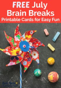 Red, white, & blue floral pinwheel, colored chalk, & bouncy balls on black chalkboard for brain breaks