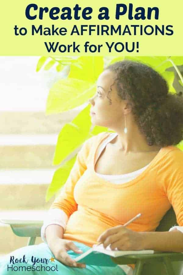 African American woman with orange top holding a green journal staring off into the sun