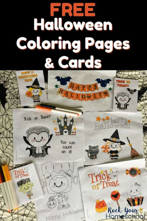 Halloween coloring pages & cards on spider web tablecloth with markers for kids to enjoy