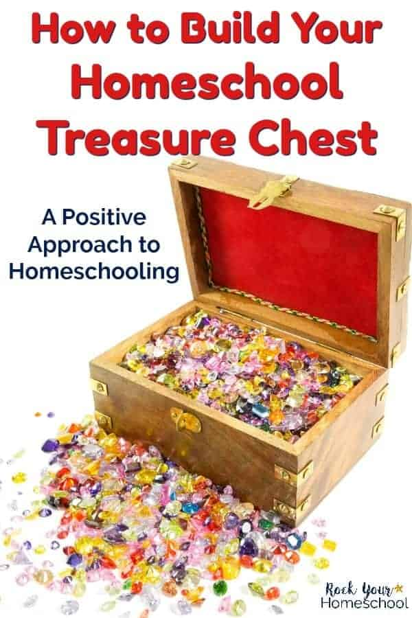 treasure chest filled with multi-colored gems & red velvet on white background