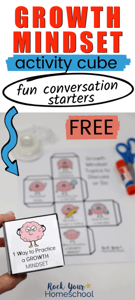 Woman holding a growth mindset activity cube with a printed page, glue stick, & blue scissors in the background to highlight the fantastic interactive learning fun you can have with this free printable with growth mindset conversation starters for kids