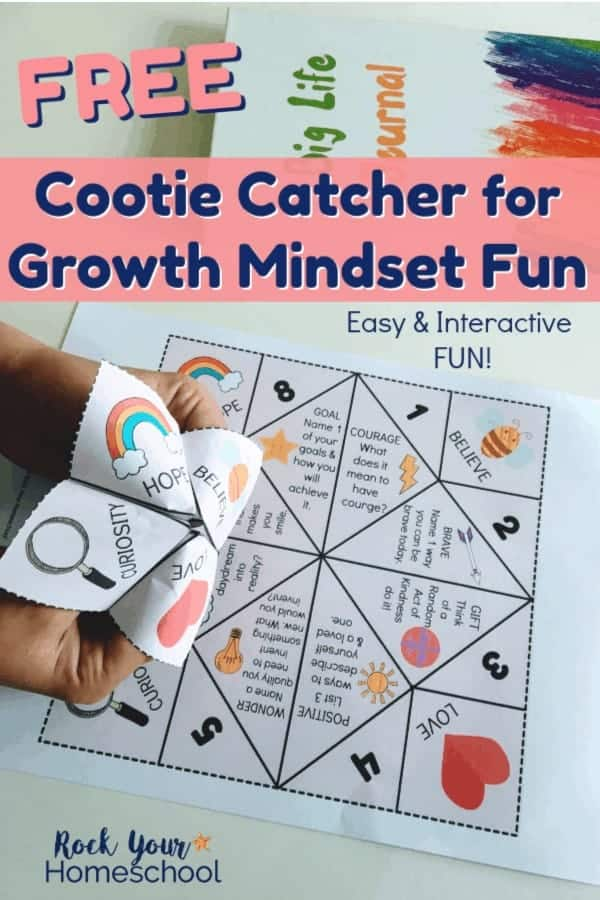 Boy using Growth Mindset Cootie Catcher with free printable & Big Life Journal on white background