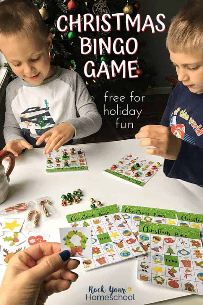 Mom playing Christmas bingo game to feature the wonderful holiday fun for kids you'll have with this set