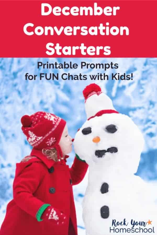 Little girl in red coat & hat whispering to snowman with snowy trees & snow in background
