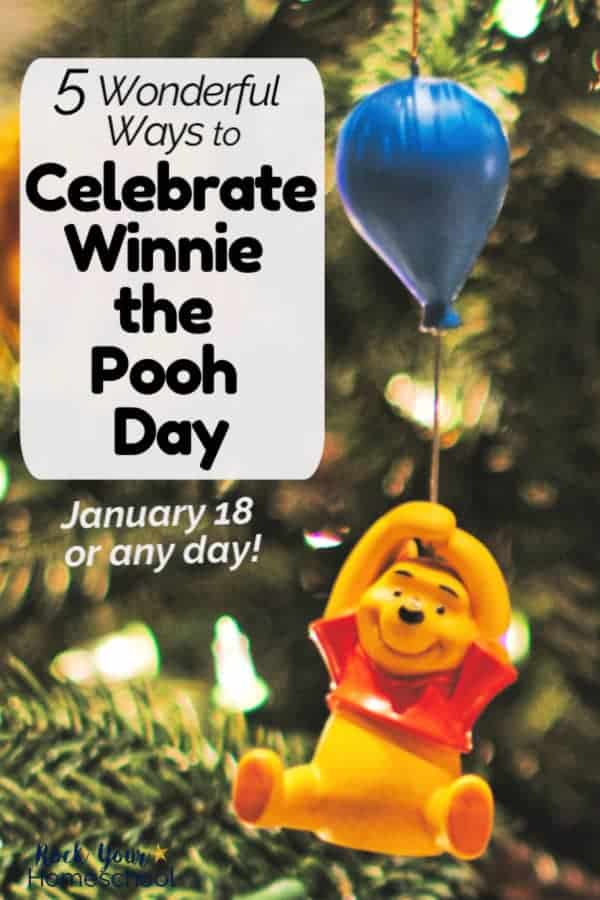 Winnie the Pooh hanging from blue balloon ornament with Christmas tree in background for a wonderful way to celebrate Winnie the Pooh Day
