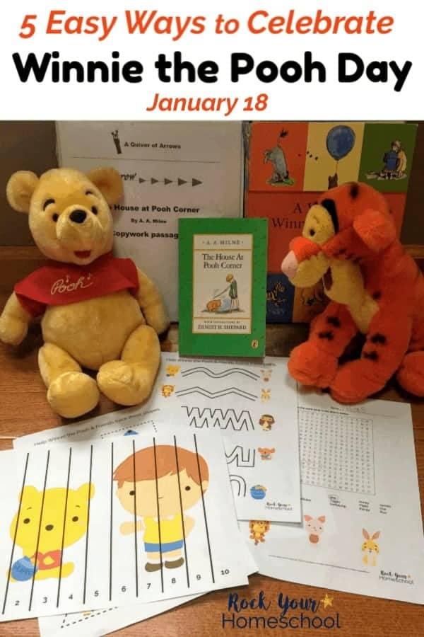 Winnie the Pooh & Tigger stuffed animals with Winnie the Pooh books & printables on hardwood floor