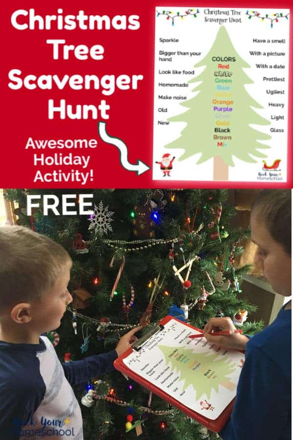 Two boys using Christmas Tree Scavenger Hunt printable list on red clipboard with Christmas tree in background
