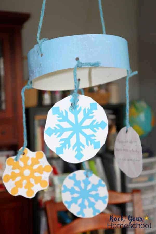 Create a beautiful Snowflake Haiku mobile using this free printable pack & guide for snowflake poetry craft for winter haiku fun.