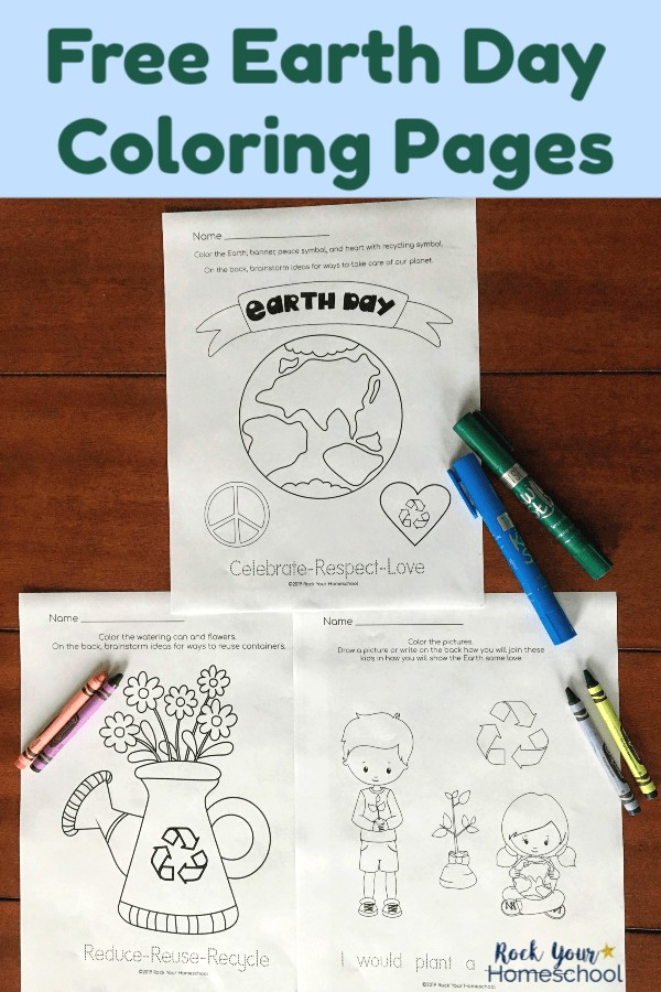 3 free Earth Day Coloring Pages on dark wood table with crayons & Kwik Stix