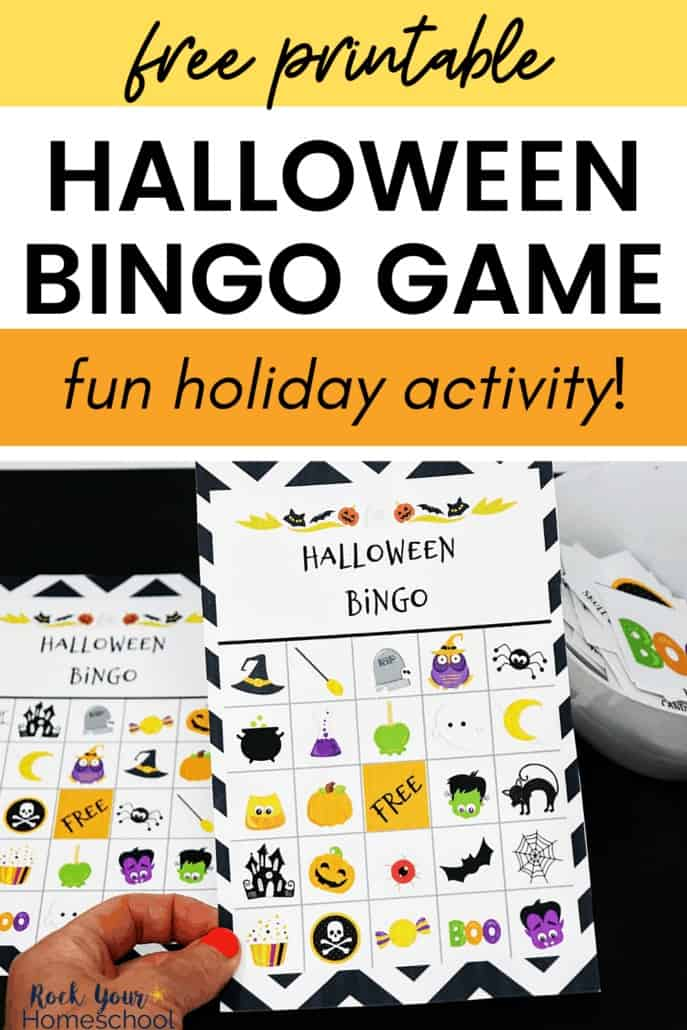 Woman holding Halloween Bingo Game card to feature the amazing holiday fun you'll have with this free printable game