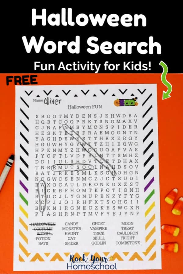 Halloween FUN Word Search on orange paper with black crayon & candy corn