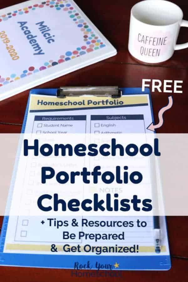 Homeschool portfolio checklist on blue clipboard with homeschool binder with colorful dots & coffee mug on dark wood table