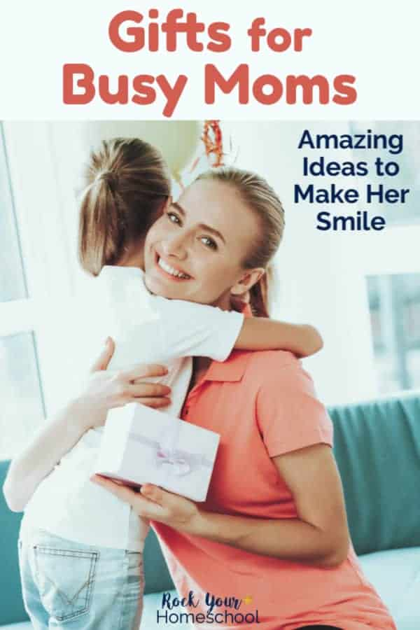 Smiling mom wearing coral polo shirt is being hugged by her daughter who just gave her mom the perfect gift for a busy mom