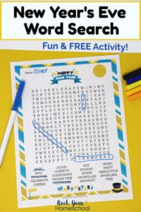 New Year's Eve Word Search with markers on yellow paper