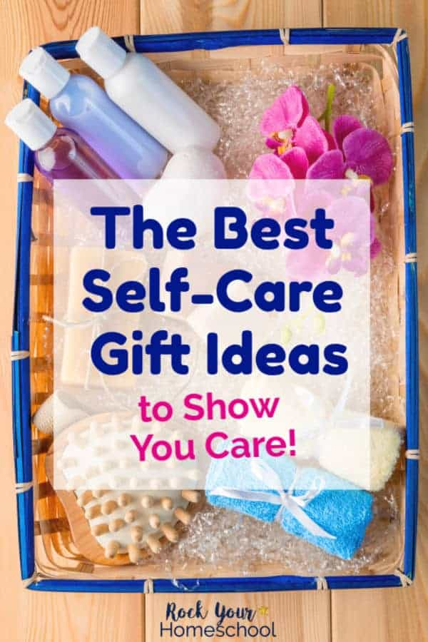 Straw basket with blue border is filled with self-care items like lotions, bath oils, shampoos, soaps, wash cloths, sponges, & flowers