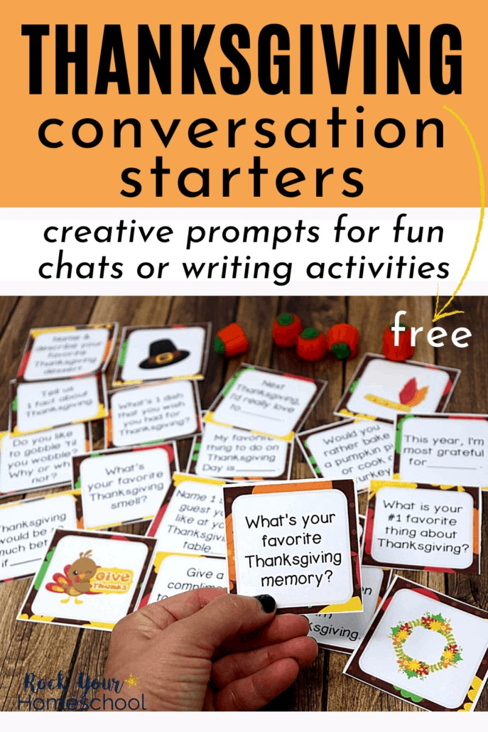 Woman holding Thanksgiving conversation starter card to feature how these conversation starters are fantastic for fun chats and writing activities