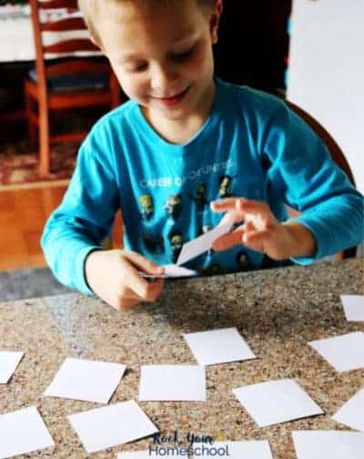 This boy is excited to practice reading with this free sight words memory game.