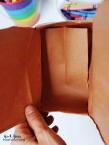 This DIY treasure box from a brown paper lunch bag is easy to make & use.