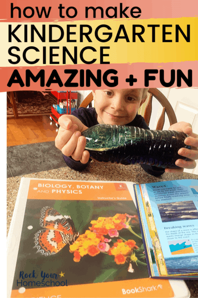 Young boy smiling as he makes a wave with a water bottle of glitter water & BookShark Kindergarten science Instructor's Guide to feature how you can easily make Kindergarten Science amazing & fun with the right resources