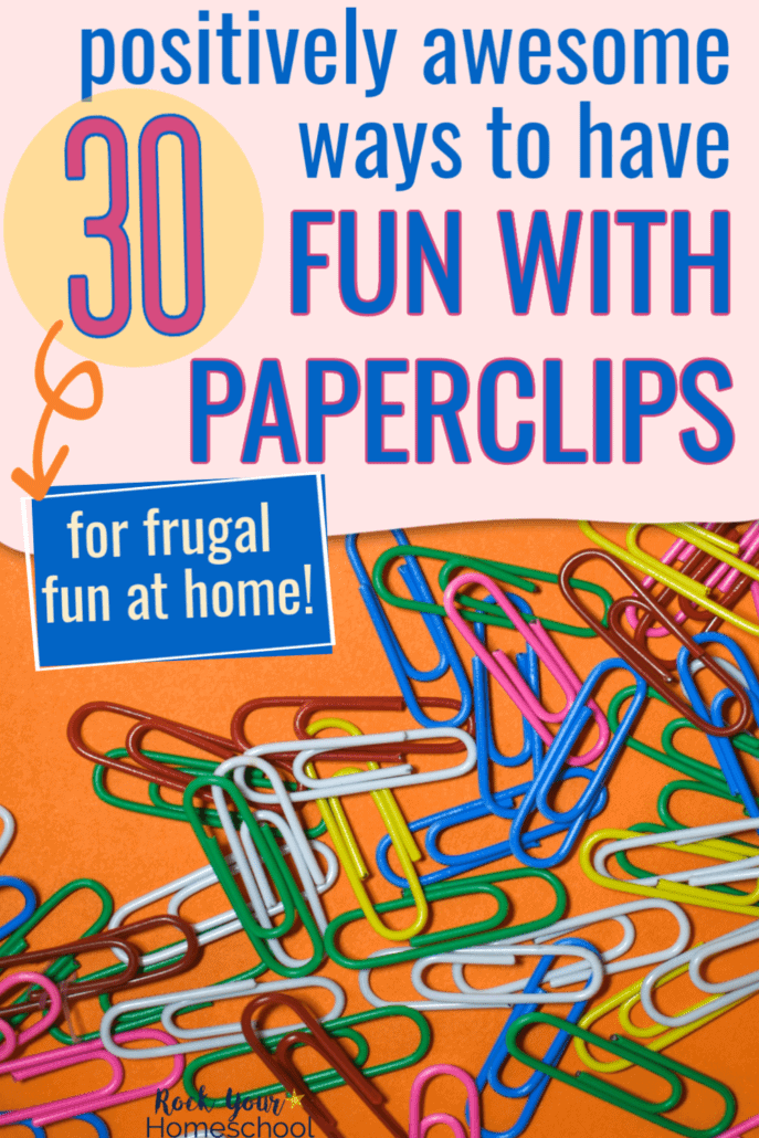 Bunch of colorful paperclips on orange paper to feature the 30 positively amazing ways you can enjoy frugal fun at home with kids using paperclips