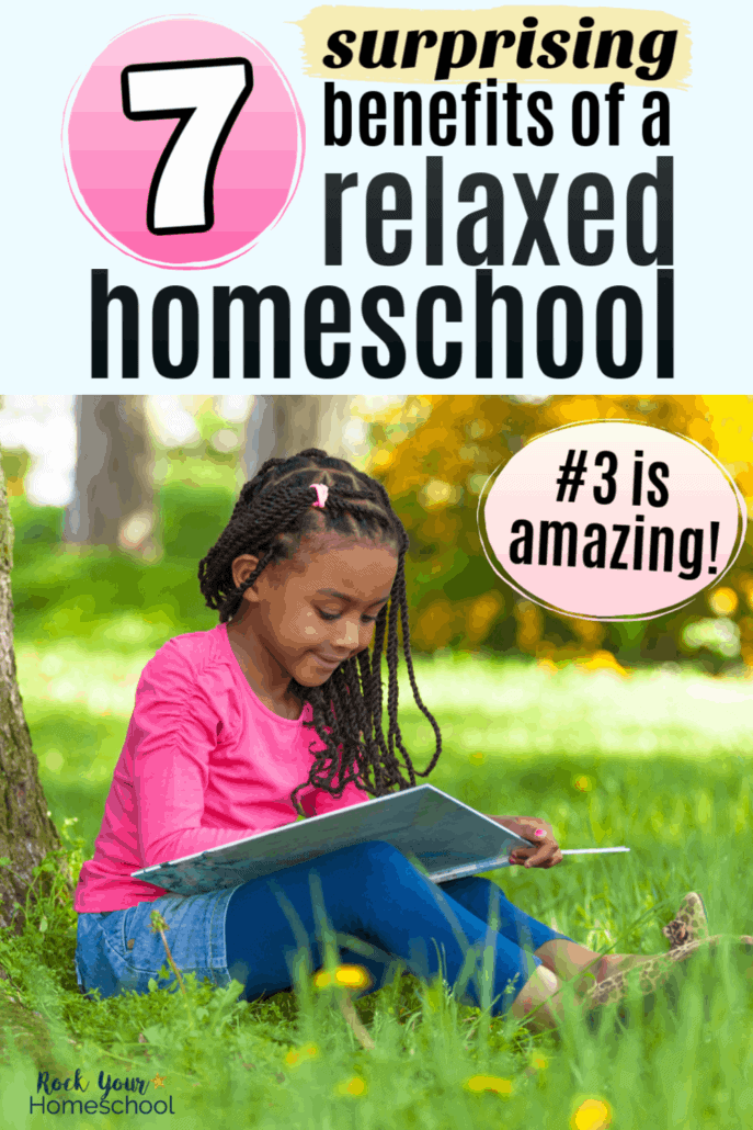 Young black girl smiling as she reads a book outside to feature the surprising benefits of a relaxed homeschool style for your family