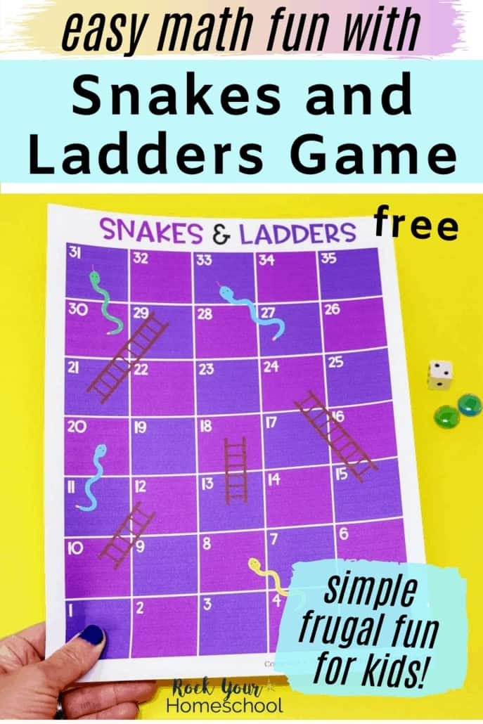 Woman holding Snakes and Ladders printable game to feature the easy math fun you can have with your kids using this Snakes and Ladders Game