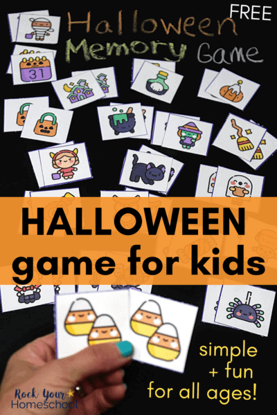 Woman holding Halloween memory game cards to feature how you can enjoy this simple free printable game with your kids for Halloween fun