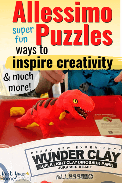 Boy with his T-Rex clay & wood craft on red tray to feature how Allessimo Puzzles are super fun ways to give your kids hands-on projects to inspire creativity & more