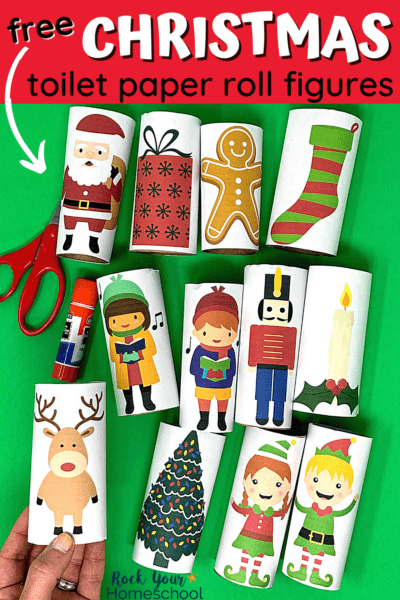 Woman holding reindeer Christmas toilet paper roll figure with other Christmas toilet paper roll figures in the background to feature the amazing holiday fun your kids will have with this free printable set