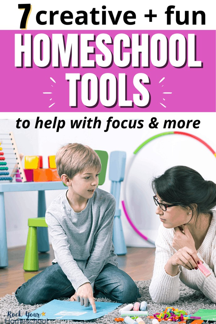 Mom & son doing homeschool work on the floor to feature how these 7 creative & fun homeschool tools can help you boost learning at home