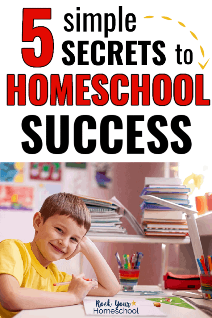 Boy smiling at his desk to feature how you can use these 5 simple secrets to homeschool success to make it more enjoyable for all